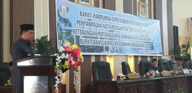 Bupati Banyuasin H. Askolani, SH., MH., Menyampaikan nota pengantar LKPJ Kepala Daerah tahun anggaran 2018. Pada rapat paripurna DPRD Banyuasin Senin (29/04/19